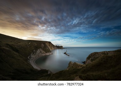 Moonlight over the Dorset Coast as the moon rises at Man O War Cove, Durdle Door, Lulworth