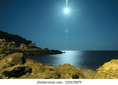 Moonlight over the Ionian Sea at Le Castella, Calabria, Italy. Summer 2012.