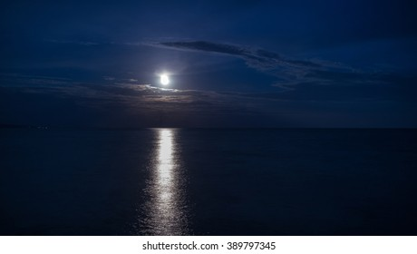 Moonlight reflects from the sea