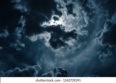 Moonlight shines behind a cloudy at night. serenity nature background.