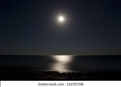 Moonlit path on the sea, night landscape.