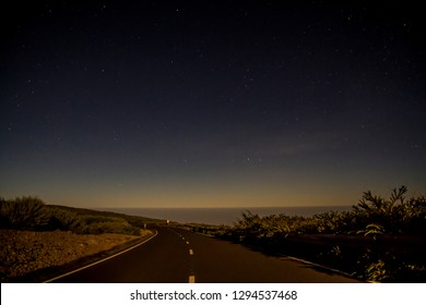 Moonlit road above the clouds