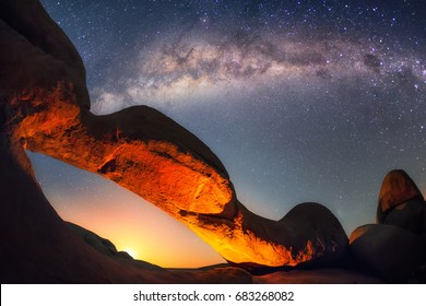 Moonrise at the Spitzkoppe's arch. Spitzkoppe is an island massif in the Namibian desert and its' mountains are of volcanic origin.