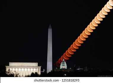 Moonrise composite over the US Capitol with Washington Monument and Jefferson Memorial in Foreground. Taken from Arlington VA near Netherlands Carillion