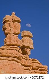 Moonrise over rock formation