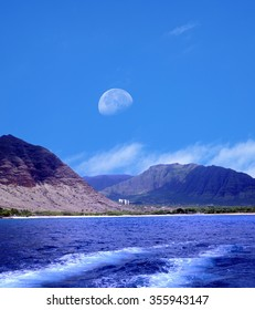 Moonrise over Small village with large hotel Oahu Hawaii