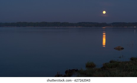 Moonset above lake Chiemsee in the Alps of Bavaria, Germany