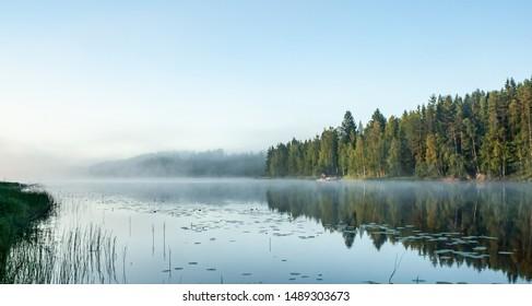 Moonset by a morning lake