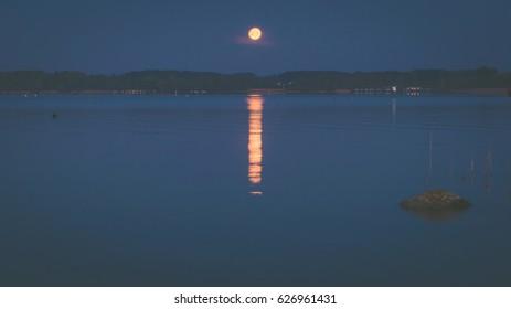 Moonset at lake Chiemsee in Bavaria, Germany