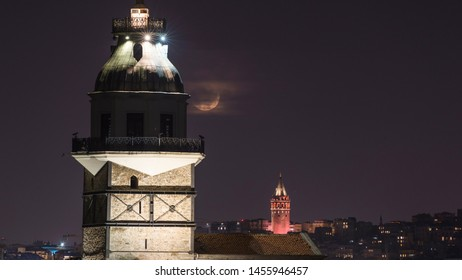 moonset at maiden tower and galata tower in istanbul