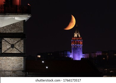 Moonset over Galata Tower in Istanbul City, Turkey