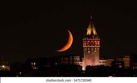 Moonset over Galata Tower in old town Istanbul. Crescent Moon Setting.
