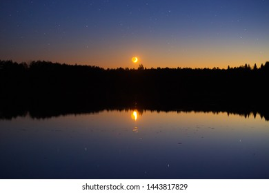 Moonset over the lake, Belarus