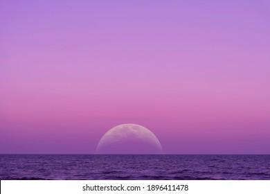 Moonset over the ocean floor. Supermoon