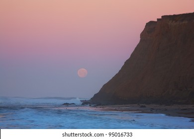 Moonset at sunrise at Half Moon Bay, California