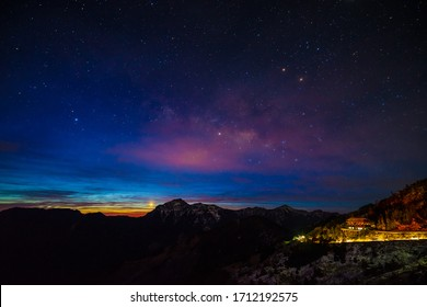 Moonsetting and sunrising at Songsyue Lodge Hehuanshan (Hehuan mountain) Taroko National Park with snow covering in winter. The moon was setting and the sun was rising and it caused colorful gradient