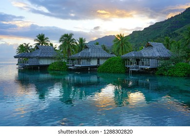MOOREA, FRENCH POLYNESIA -30 NOV 2018- Sunset view of overwater bungalows on the lagoon at the Intercontinental Moorea Lagoon Resort and Spa, a luxury hotel located in Moorea, French Polynesia.