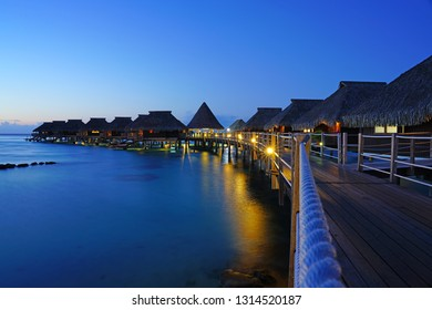 MOOREA, FRENCH POLYNESIA -30 NOV 2018- Sunset evening view of the Hilton Moorea Lagoon Resort & Spa, a luxury hotel with overwater bungalow villas on the lagoon in  Moorea, French Polynesia.