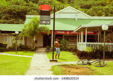 Moorea/French Polynesia 05/03/2019 : the colourful house close to the beach with a man in Moorea, French Polynesia
