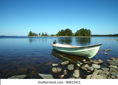 Moored boat on the calm lake