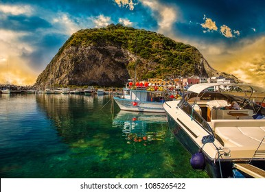 moored boats in marina under promontory of Ischia island, Naples in Italy