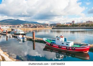 Moored boats on the pier of Vilagarcia de Arousa harbor