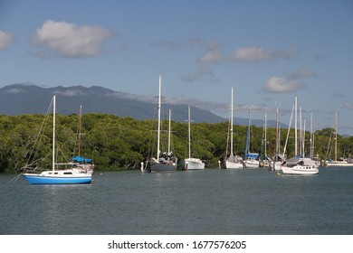 Moored boats in the Port Douglas Inlet at Port Douglas, Queensland, Australia.