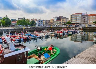 Moored boats in Vilaxoan fishing harbor, Vilagarcia de Arousa town, Galicia
