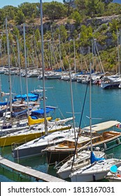 Moored boats and yachts in Calanque de Port Miou, department of Bouches-du-Rhone, France. July 25, 2020 Editorial photo