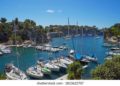 Moored boats and yachts in Calanque de Port Miou, department of Bouches-du-Rhône, France. July 25, 2020 Editorial photo
