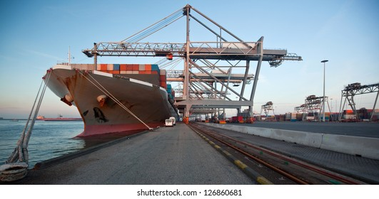 Moored container ship and gantry cranes