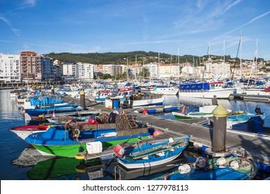 Moored fishing boats on the harbor dock of Sanxenxo touristic city
