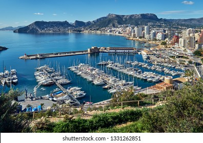 Moored nautical vessels yachts motorboats in the marina harbor of Calpe resort city in the southern Spain. Province of Alicante, Spain
