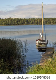 Moored sailboat on the calm waters of the lake. Mazury,Poland.