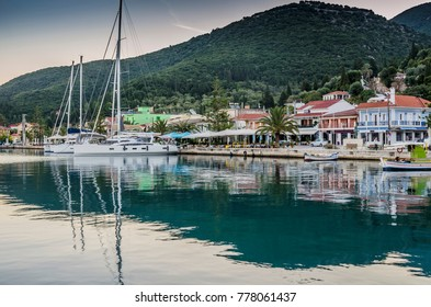 Moored sailboats and facilities of Sami harbor on an October sunrise on the island of Kefalonia over the Ionian sea Greece