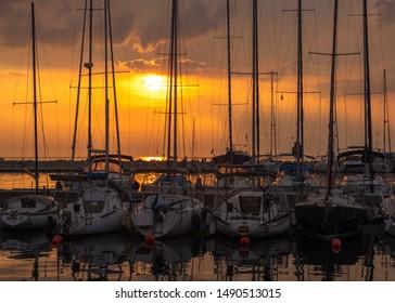 Moored sailboats in Piran at sunset