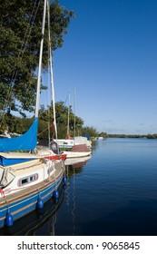 Moored sailing yachts moored on a calm lake