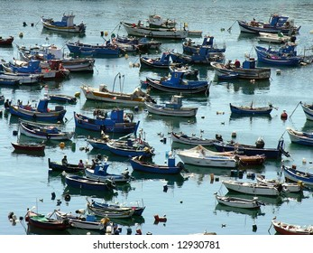 Moored traditional fishing boats in a typical harbor, in the south west coast of Portugal, sines