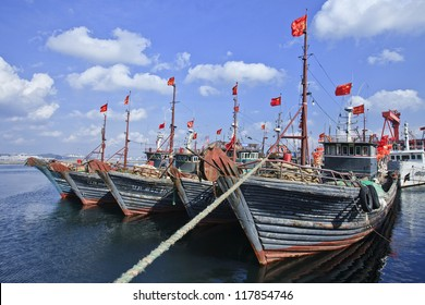 Moored wooden fishing boat in Dalian, China