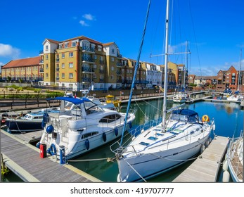 The moored yachts and luxury houses in Sovereign Harbour Marina, Eastbourne, East Sussex, England