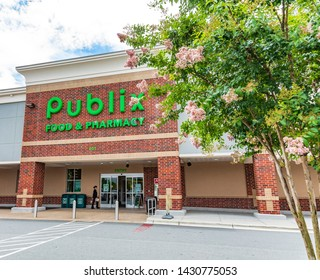 MOORESVILLE, NC, USA-JUNE 19, 2019: Publix Food & Pharmacy building and  parking lot.