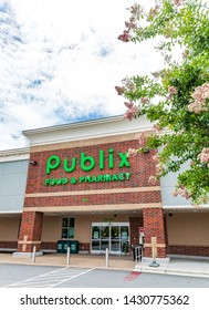 MOORESVILLE, NC, USA-JUNE 19, 2019: Publix Food & Pharmacy building and busy parking lot. Vertical image.