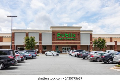 MOORESVILLE, NC, USA-JUNE 19, 2019: Publix Food & Pharmacy building and busy parking lot.
