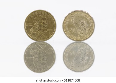 Moorhead, United States - November 7, 2016: Dollar coins facing camera, isolated on white with mirrored reflection