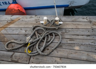 Mooring Bollard with rope on pier by the sea.