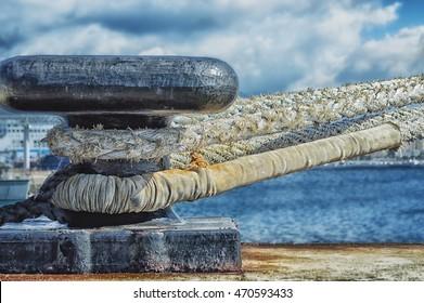 Mooring bollard with ship ropes