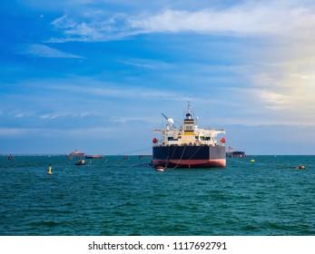 Mooring Buoy operation assistance vessel tanker at sea.