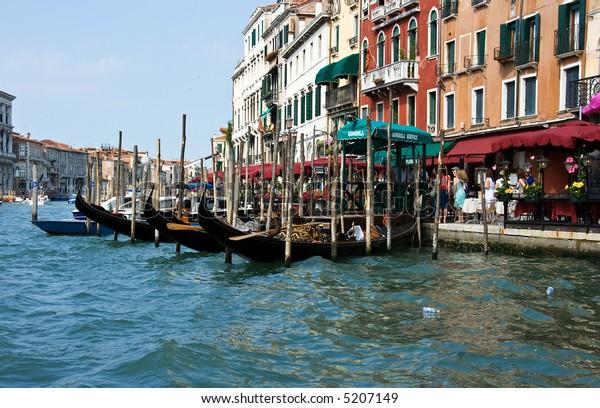 Mooring for gondolas at  the grand canal. Venice. Italy.