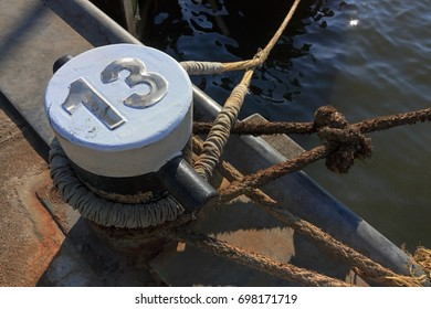 Mooring lines and bollard with number 13