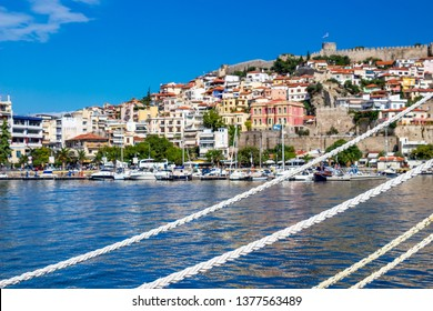 Mooring lines in front of a blurred view of the Port of Kavalla with the old town, Eastern Macedonia, Northern Greece